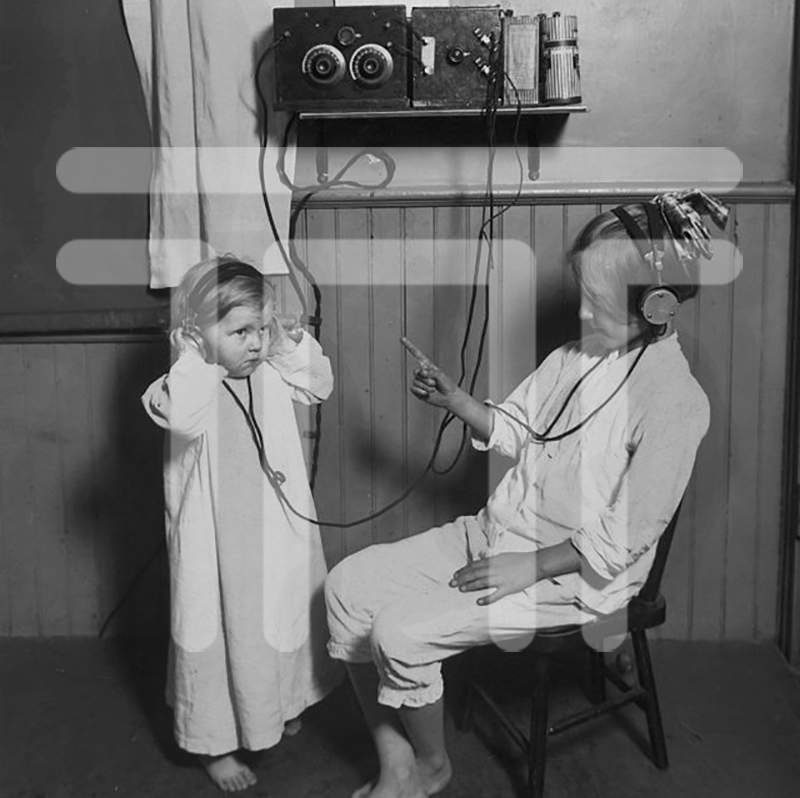 Two children listen to a radio. - [ca. 1924]